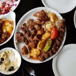 Mixed grill, saksuka, and hummus
