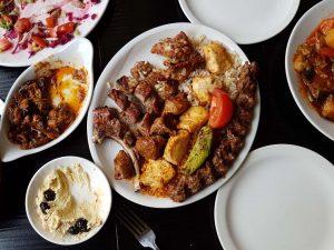 Mixed grill, saksuka, and hummus